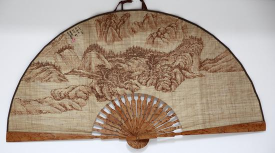 A traditional Rongchang folding fan made of local ramie fabric. (Photo/China Today)