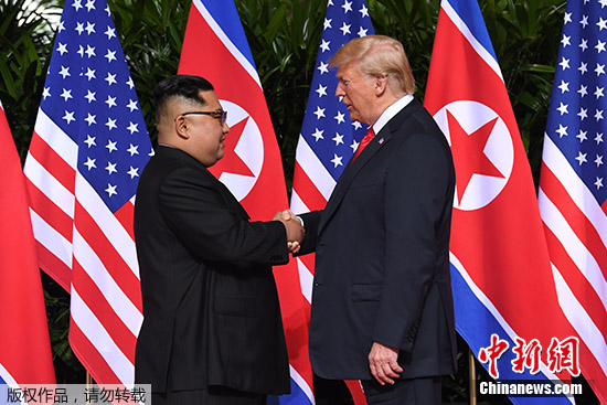 Top leader of the Democratic People's Republic of Korea (DPRK) Kim Jong Un  (L))and U.S. President Donald Trump share a historic handshake Tuesday morning in Singapore. (Photo/Agencies)