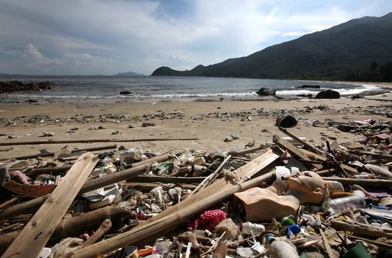 Ocean debris lies on the beach at Big Wave Bay in Shek O, Hong Kong.  (Photo by PARKER ZHENG/CHINA DAILY)