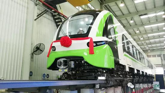 A new generation domestic medium-low-speed magnetic levitation (maglev) train rolls off the production line in Hunan, June 13, 2018. (Photo courtesy of maglev research institute of the CRRC )