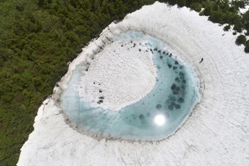 'Dragon eye' shaped pond seen on Japan mountain