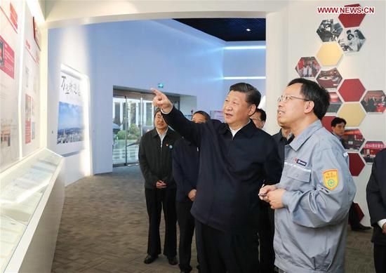 Chinese President Xi Jinping, also general secretary of the Communist Party of China Central Committee and chairman of the Central Military Commission, visits an industrial park of Wanhua Chemical during an inspection tour in Yantai, east China's Shandong Province, June 13, 2018. (Xinhua/Xie Huanchi)