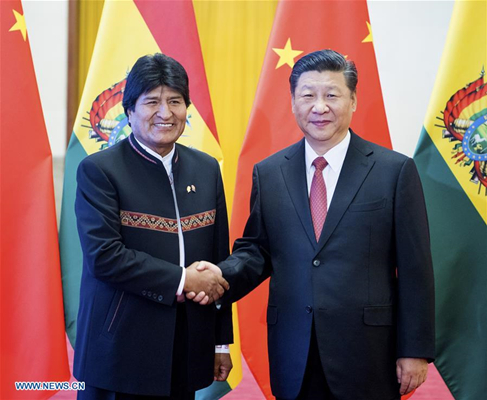 Chinese President Xi Jinping (R) shakes hands with Bolivian President Juan Evo Morales Ayma during a welcoming ceremony at the Great Hall of the People in Beijing, capital of China, June 19, 2018. Xi Jinping held talks with Juan Evo Morales Ayma on Tuesday. (Xinhua/Li Xueren)
