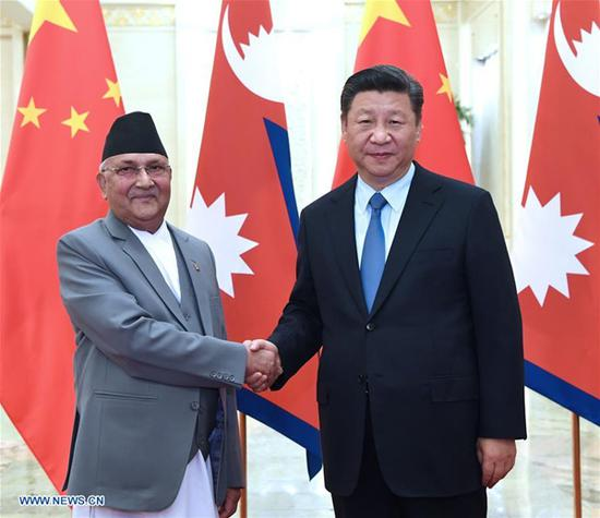 Chinese President Xi Jinping meets with Nepal's Prime Minister K.P. Sharma Oli at the Great Hall of the People in Beijing, capital of China, June 20, 2018. (Xinhua/Rao Aimin)