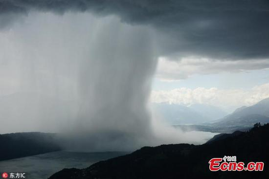 Incredible rainstorm over a lake in Austria