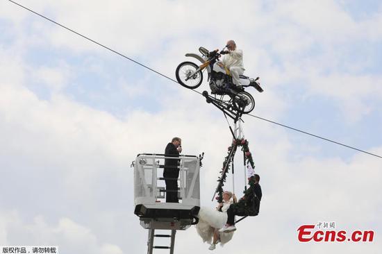 German couple married in tightrope wedding