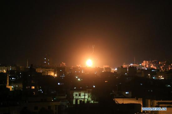 An explosion is seen in northern Gaza city on June 20, 2018. The Israeli military said Wednesday its aircraft had struck overnight about 25 Hamas sites in Gaza after Palestinian militants launched rockets and mortars at southern Israel. (Xinhua)