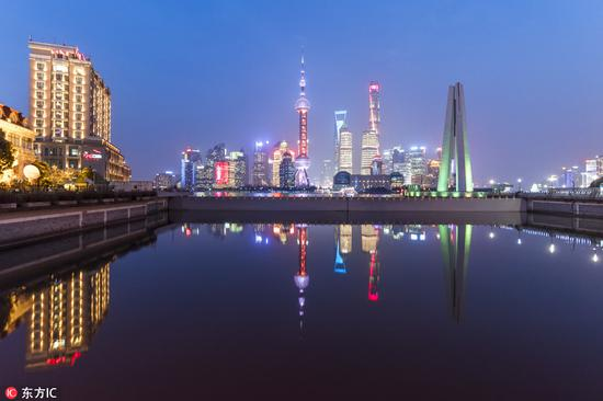 Shanghai maps out 100 steps to open further