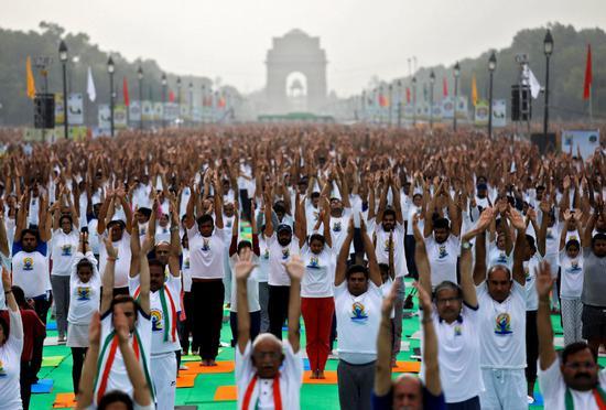 World strikes pose for Yoga Day