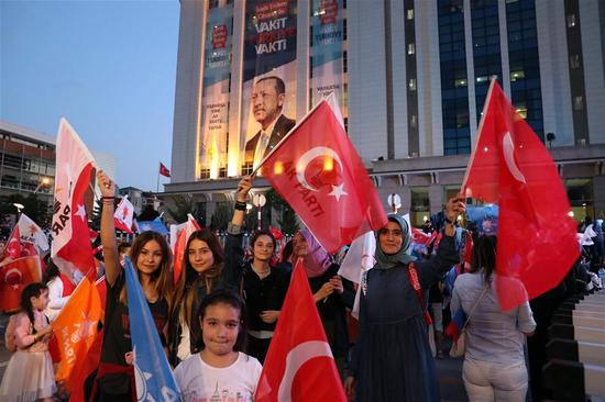 Supporters of Turkish President Recep Tayyip Erdogan rally in front of the Justice and Development Party (AKP) headquarters in Ankara, Turkey, on June 24, 2018.  (Xinhua/Mustafa Kaya)