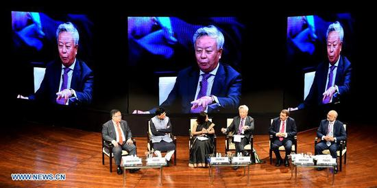 President of the Asian Infrastructure Investment Bank (AIIB) Jin Liqun (3rd R) speaks at the third annual meeting of AIIB in Mumbai, India, June 25, 2018.  (Xinhua/Zhang Naijie)