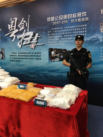 Guangdong police seized more than 5.4 metric tons of narcotics, mostly crystal methamphetamine and ketamine, between January and May, up from 5.1 tons in the first five months of last year.  (Photo by Zheng Caixoing/China Daily)