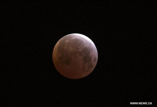 Photo taken on April 4, 2015 shows a total lunar eclipse observed in Tijuana, Baja California, in the northwest of Mexico. (Photo: Xinhua/Guillermo Arias)