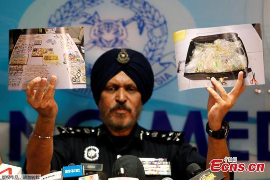 Police seize haul of cash, luxury items from former PM Najib's premises
