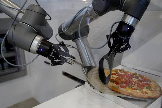 Fancy a Margherita? Robot serves up pizzas in France
