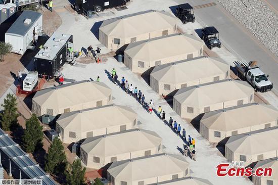 Tent city for migrant children puts Texas border town in spotlight
