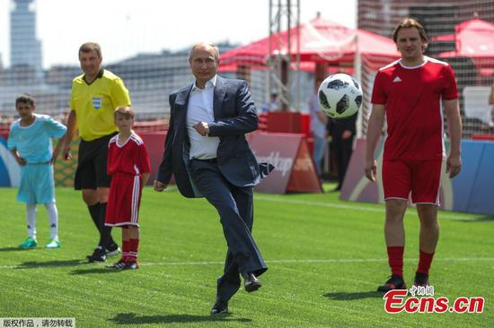Putin, Infantino have a kick-about on Red Square
