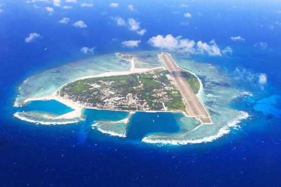 China strongly opposes US warship sailing near China's islands in South China Sea