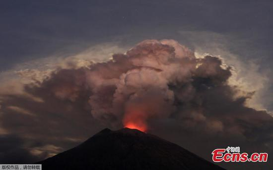 Ash from Bali volcano shuts airport, villagers flee