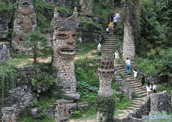 Artist creates stone castle 'Yelang' in home province Guizhou