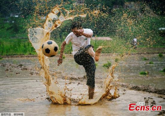Nepalese kick off National Paddy Day with soccer game