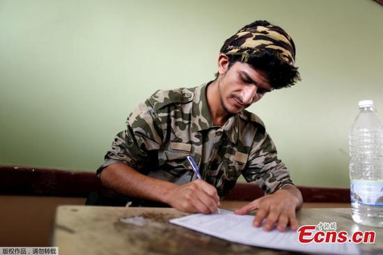 Yemen high school students taking test