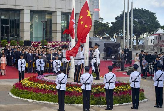 A flag-raising ceremony on Sunday at Golden Bauhinia Square in Hong Kong marks the 21st anniversary of the city's return to the motherland. (Photo/China News Service)