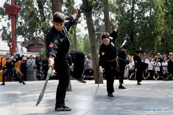 American Kungfu enthusiasts perform martial arts with local monks at Shaolin Temple