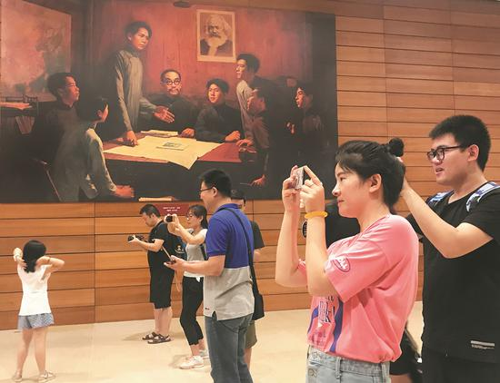 Faculty from Hebei University's College of Chemistry and Environmental Science, organized by the school's Party committee, visit an exhibit at the National Museum of China in Beijing on Sunday to mark the Communist Party of China's 97th birthday. (XU JINGXING / CHINA DAILY)