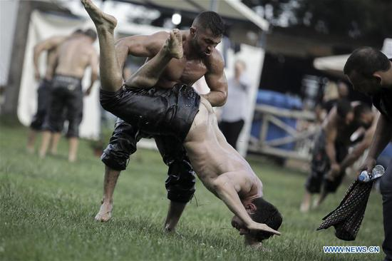 Traditional oil wrestling competition held in Greek village of Sohos