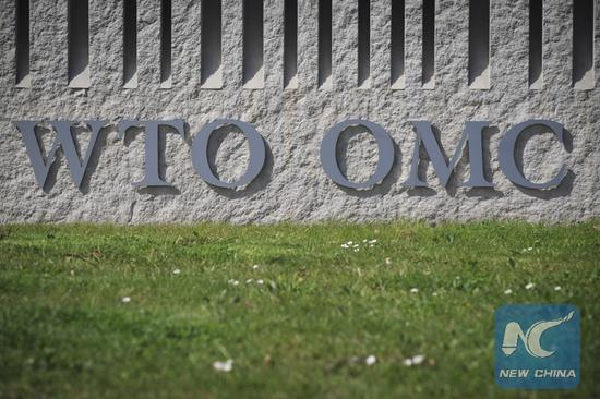Photo taken on April 12, 2018 shows the abbreviation WTO on the wall of the World Trade Organization headquarters in Geneva, Switzerland. (Xinhua/Xu Jinquan)
