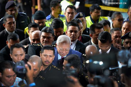 Former Malaysian Prime Minister Najib Razak (C) arrives at a court in Kuala Lumpur, Malaysia, on July 4, 2018. Malaysia's public prosecutors charged former Prime Minister Najib Razak Wednesday with criminal breach of trust on misappropriation of funds. (Xinhua/Chong Voon Chung)