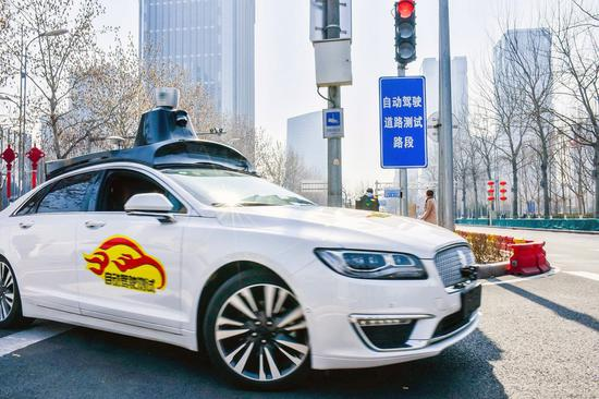 Baidu Apollo self-driving cars being tested on open roads in Beijing on March 22, 2018. (Photo/Asianewsphoto)