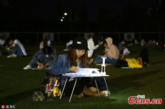 Students study on football field