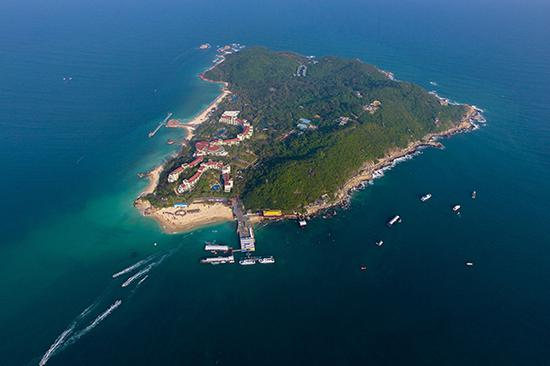 Wuzhizhou Island, off the coast of Sanya, Hainan Province, is now a popular tourist attraction in the tropical paradise. (Photo by Xing Guangli/Xinhua)