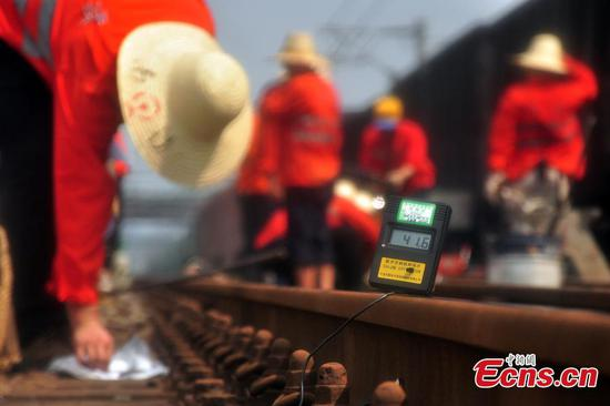 Railway workers race against time on busy line