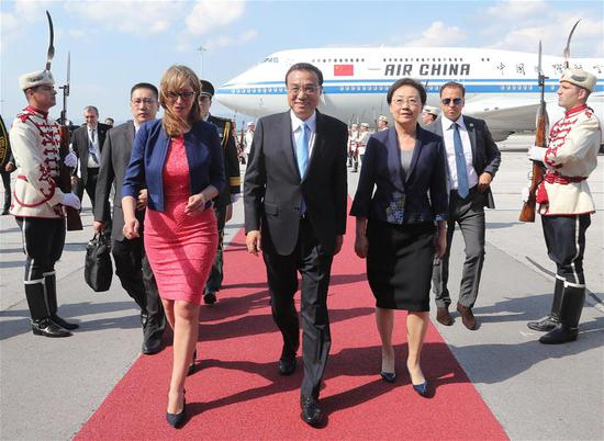 Chinese Premier Li Keqiang (C, front) arrives in Bulgaria on July 5, 2018, for an official visit to the country and the seventh meeting of heads of government of China and 16 Central and Eastern European Countries (CEEC) in Sofia. Li's visit is being made at the invitation of Bulgarian Prime Minister Boyko Borissov. (Xinhua/Liu Weibing)