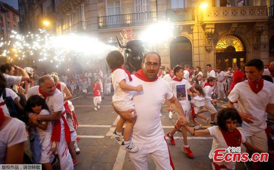 Revelers welcome Pamplona's annual bull-running fiesta
