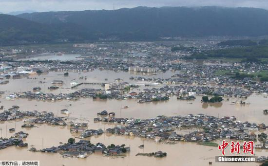 Aerial view shows houses in Okayama prefecture was in the flood. (Photo/Agencies)