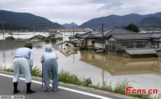 Death toll from torrential rain in Japan flood rises to 126