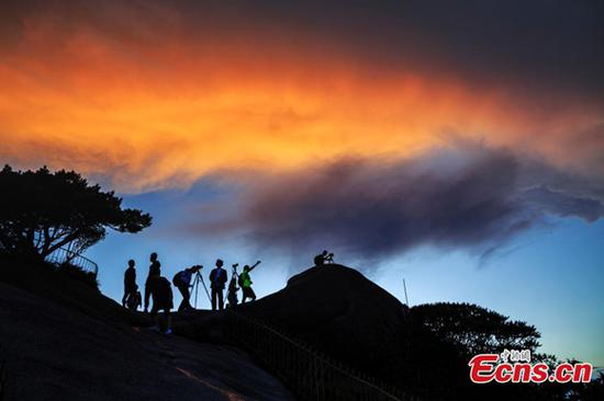Sunset glow casts fantastic colors to Huangshan Mountain