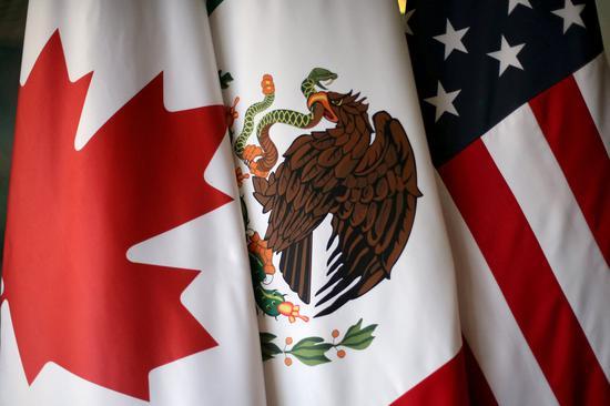 Canadian, U.S., Mexican automakers urge return to NAFTA talks