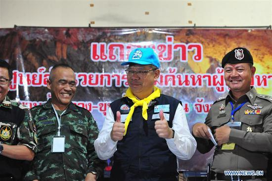 Narongsak Osatanakorn (2nd R), head of the joint command center coordinating the rescue operation, reacts at a press briefing in Chiang Rai, Thailand, July 10, 2018. All 12 boys and their football coach have been rescued from a flooded cave in northern Thailand after being trapped for 18 days, rescuers said on Tuesday. (Xinhua/Rachen Sageamsak)