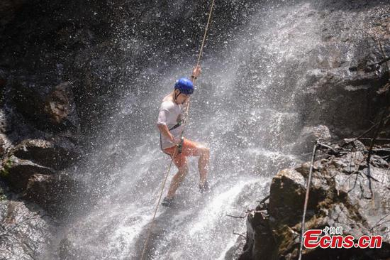 Abseiling down 106-meter cliff waterfall