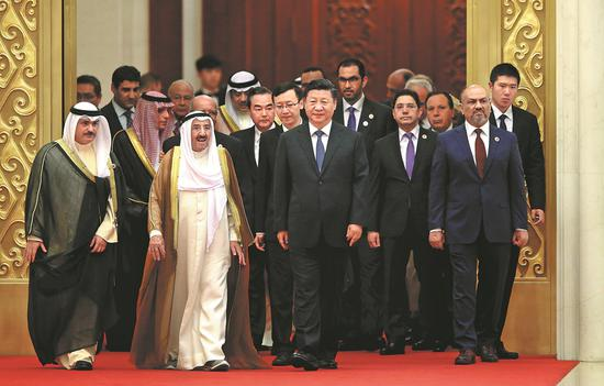 President Xi Jinping and guests enter the Great Hall of the People in Beijing for the opening ceremony of the eighth ministerial meeting of the China-Arab States Cooperation Forum on Tuesday morning. Xi said China and Arab countries should promote vitalization in the Middle East. (FENG YONGBIN / CHINA DAILY)