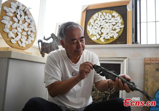 Teacher fascinated with vivid iron artworks
