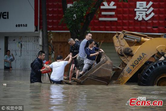 Bulldozer transports people in flood-hit county
