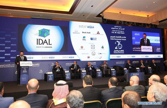 Lebanese Prime Minister Saad Hariri (1st L) addresses the opening ceremony of the 26th Arab Economic Forum in Beirut, Lebanon, on July 12, 2018. Arab analysts hailed the cooperation between China and the Arab world, and expected more projects and investments under the China-proposed Belt and Road Initiative here on the sidelines of the 26th Arab Economic Forum. (Xinhua/Li Liangyong)