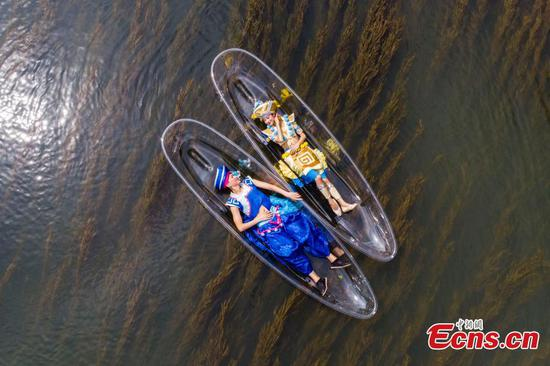 Ride in transparent kayaks on Lijiang River