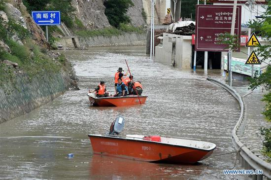 Rescue work underway in flooded areas in Zhouqu County, Gansu
